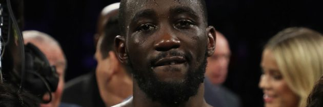 Crawford stops Khan after low blow in sixth round