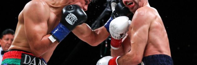 Roman beats Doheny in 12-round war to unify titles
