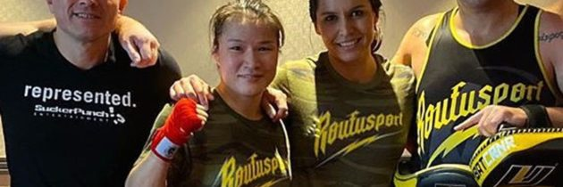 Comrades In Arms: Weili Zhang Trains With Tulsi Gabbard