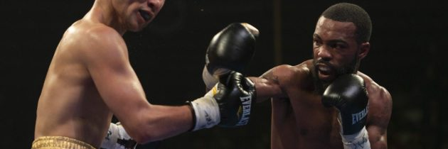 Russell keeps WBC belt with decision over Nyambayar